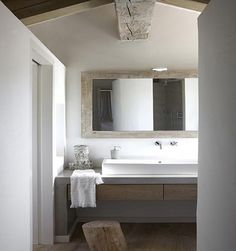 natural materials - concrete vanity, linen towels, wood mirror frame.  naturally modern!