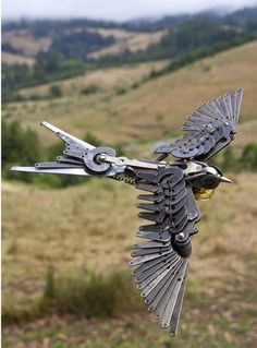 Flying bird sculpture by Jeremy Mayer - photo from steampunktendencies