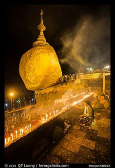 Offerings to the Buddha continues throughout the night at the Golden Rock. Kyaiktiyo, Myanmar