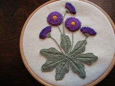 Embroidery, perle no. 8. Long Blanket stitch leaves, bullion knots, needleweaving, French knots and lazy daisies.