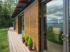 A Blu Home on Vashon Island, WA  Exterior sliding shades