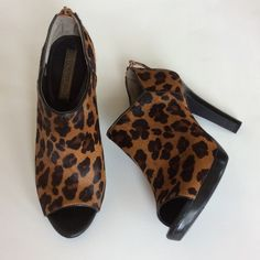 """Banana Republic Calf Hair booties Banana Republic open toed, calf hair booties. Animal print, brown and black. Leather trim. 4 1/4"""" heel with 1/2"""" platform. Zip in back for easy slip on. Size 7.5. Excellent condition. Banana Republic Shoes Ankle Boots & Booties"""