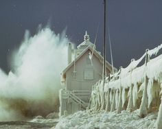 Grand Haven Lighthouse in storm on Lake Michigan. Photo by Carl Ter Haar (courtesy Michigan Travel Bureau). Lago Michigan, Michigan Travel, Michigan Usa, Northern Michigan, Minnesota, Scenic Wallpaper, Hd Wallpaper, Ice Storm, Storm Lake