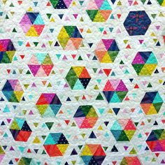 """We ❤️ this ""Swarm"" quilt by Selena Cheng @seldear for the #quiltcon Triangle Quilt Challenge. #cottonandsteel"""