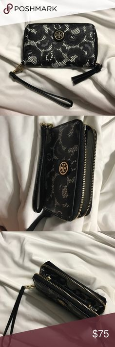 Tory Burch Wallet Tory Burch wrislet wallet. Black and white flower and lace design. Zip around. Tory Burch Bags Clutches & Wristlets