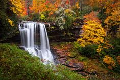 Autumn at Dry Falls in Highlands NC. We absolutely love Highlands NC for all the great sights, roads, food, people and more! Dry Falls is one of the reasons we are so fond of Highlands and it is easy to see why. This is an epic waterfall in the heart of the Blue Ridge Mountains of Western North Carolina, and during the fall foliage it is really something special to see.