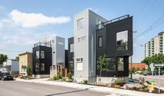 Built by Colizza Bruni Architecture Inc. in Ottawa, Canada with date Images by Peter Fritz. THE PREAMBLE The residential infill development of THE HINTONBURG SIX is an example of looking back at the history o. Architecture Details, Architecture Design, Sea Container Homes, Metal Siding, Landscape Materials, Storey Homes, Social Housing, Affordable Housing, Modern Landscaping
