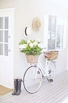 White vintage bike, hydrangeas, beach hats, Hunters. LOVE this.