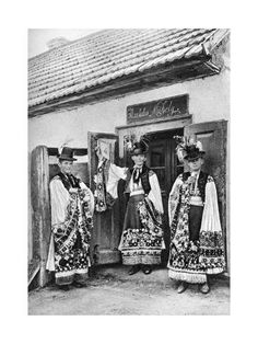 Three young men stand next to a doorway in their Sunday costumes. National Geographic Images, Folk Dance, Fantasy Inspiration, Priest, Image Collection, Hungary, Costumes, Folk Costume, Alice In Wonderland