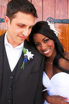 "Absolutely beautiful interracial couple on their wedding day. Check out an interracial couples blog called ""What the heck does race have to do with it!"" @ britneymonique.blogspot.com. Go there an sahre you intrest or your experience of being in a interracial relationship."