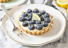 Lemon and Blueberry Tartlets. These Lemon and Blueberry Tartlets are packed with citrus goodness and topped with juicy blueberries creating one fabulous dessert! Best Blueberry Muffins, Blueberry Crumble, Blueberry Recipes, Blue Berry Muffins, Lemon Tartlets, Dessert Places, Summer Desserts, Autumn Desserts, Summer Food