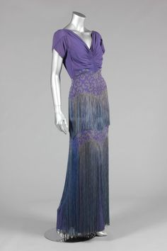1930s Mainbocher purple satin-backed crêpe evening gown labeled '12 Avenue George V, Paris', with ruched bodice and fringe.