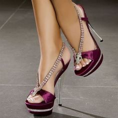 Wine colored stilettos with rhinestone straps and clear heels. Very pretty