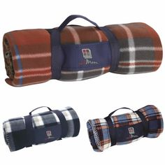 Travel Blanket (PPO# Plaid blanket with removable carrying strap. Materials: Polyester polar fleece Heat Transfer: Strap, x 4 color(s) max. Product Size: x Available Colors: Blue/Cream Plaid, Blue/Rust Plaid, Rust/Plaid Promotional Pens, Plaid Blanket, Personalised Blankets, Spirit Wear, Travel Logo, Custom Embroidery, Polar Fleece, Holiday Outfits, Outdoor Travel