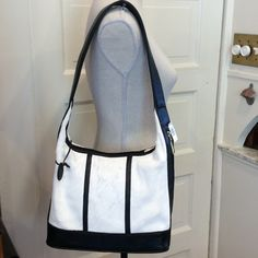 NEW COWHIDE LEATHER SHOULDER BAG Gorgeous Hair on Hide shoulder Bag,crafted with black leather and white hidesHas extra long strap length,clean interior has one zippered pocketAlso has a side zip pocket KAYMAN Bags Shoulder Bags