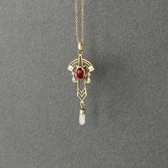 This type of necklace is called a lavalier...I received one, a family heirloom, as a present for Christmas, and Downton Abbey has only fueled my new interest in Victorian/Edwardian jewelry! This one is not as pretty as mine, though.