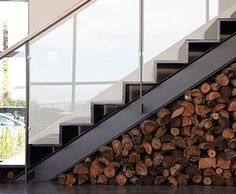 Martin specializes in unexpected details: for instance, a custom steel staircase with space to store logs beneath.