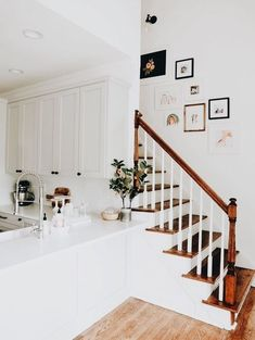 white cabinets and wooden stairs