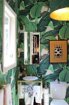 """all over the Beverly Hills Hotel. It creates an exotic mood, The scale is the fun of it."""" -Harry Hinson, Hinson  Co. Wallpaper: MARTINIQUE IN GREEN"""