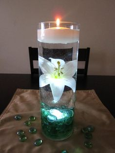 cute, simple! do-able and cheap! because the ribbon of vase is this teal i would go purple beads and maybe a royal blue candle