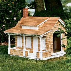 The Craftsman aesthetic—natural materials, handcrafted details, and simple lines—shows in the cedar-shingle siding, the tapered porch posts atop stout piers, and the exposed rafter tails. The roof, with its wide shed dormer and gentle crook where it meets the porch, is another hallmark of the style. And it's a DOGHOUSE!