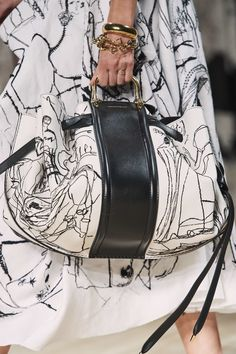 Alexander McQueen Spring 2020 Ready-to-Wear Collection - Vogue - white sleeveless A-line dress with black freehand embroidery - skirt side and matching purse Popular Handbags, Cute Handbags, Cheap Handbags, Luxury Handbags, Purses And Handbags, Luxury Bags, Luxury Purses, Trendy Handbags, Canvas Handbags