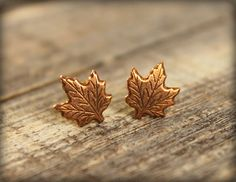 These cute little maple leaves measure about 3/8 of an inch in diameter and have been securely attached to gold-plated nickel free earring posts.