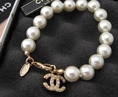 Pearl bracelet by Chanel.