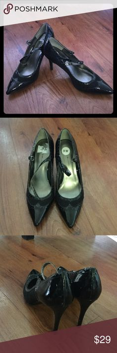 High heel pumps Black patent leather pumps with vintage detail. Strap across front. 2.5/3 inch heel! Barely worn. Great condition!! Bandolino Shoes Heels