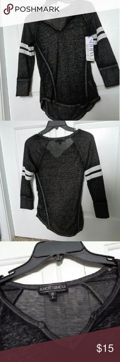 Black sleeved shirt Black whith white stripes on arms, long sleeved shirt. Sheer material, super soft and comfortable. Slight hi-low effect on bottom as seem in first picture. Almost Famous Tops Tees - Long Sleeve