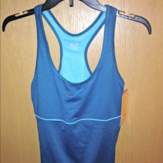 NWT L Champion dry fit teal workout tank dri fit FINAL PRICE DROP!!! Brand New! NWT Champion C9 Duo Dry Max teal workout tank w/built-in bra. Sz Large. Soft comfortable and perfect for getting in shape! Dry fit Wicks moisture fast. 4 way stretch. Form fitting compression for peak performance and flattering fit. Inner bra for added support, removable cups for added shape. Flat lock seams on inner bra reduce chafing. Brand New w/Tags. Water bottle/DVD/bike not included. Champion Tops Tank Tops