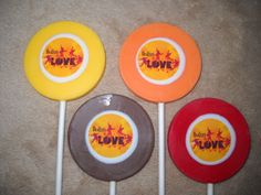"""1.50 = edible decal 2 1/4"""" round lollipop. sold individually. made to ship 3 weeks after payment - provide the following for a price quote * event date * quantity * state * zip code * email address emails checked every 35min when in chocolate room from 6am - 10pm or you may text me any hour when you are online Chauntelle castlerockchocolates at yahoo.com 307/899-7100 text any hour"""