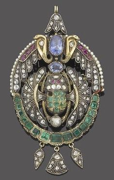 A gem-set and seed pearl brooch pendant, circa 1900.