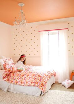Love this color scheme and paint job for a girls room! Plus, that coral ceiling is everything. #biggirlroom