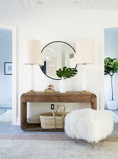 beautiful wood console table with natural textures and a round mirror // Our Bright and Airy Makeover of Erin Fetherston's Home