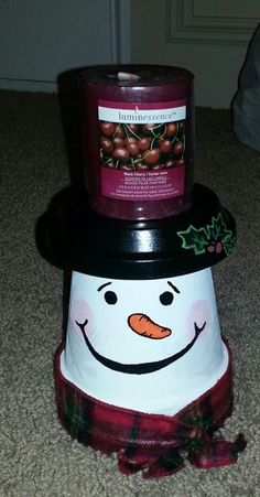Clay pot candle holder.