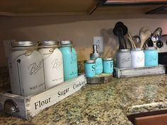 COMPLETE SET!! Utensil holder-(3) wide mouth quart jars canister set-(3) 1/2 gallon mason jars salt and pepper-(2) 1/2 pint jars soap dispenser-(1) pint jar I LOVE doing custom orders so PLEASE message me with any special orders youd like me to make Choose from our wide range of