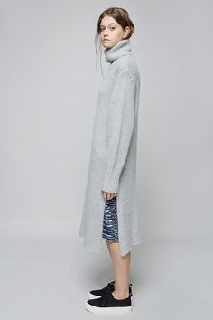 """love the layering...and how long the sweater dress is with the """"pants"""" underneath...unexpected and cool"""
