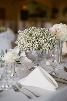 i love short arrangements. babys breath is so simple and chic.