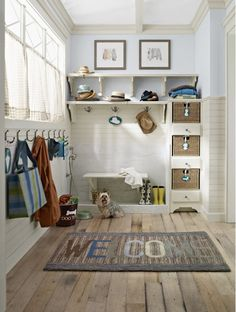Entry/ Mud room design with tons of storage space for coats and shoes
