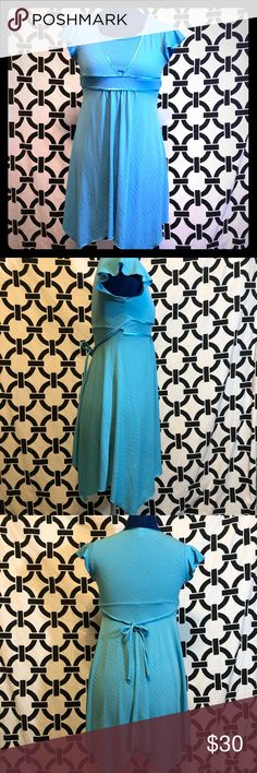 Girls Skater Dress Girls skater dress in beautiful blue with silver spots. Ties in back. Shark tooth cut on skirt! Absolutely adorable!!! Speechless Dresses Casual
