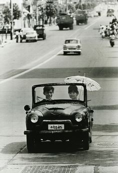 Tokyo... Going on a drive in a handmade car - the car ownership boom as it was. Modern print. 1962. Photo by Takeyoshi Tanuma (田沼 武能). °