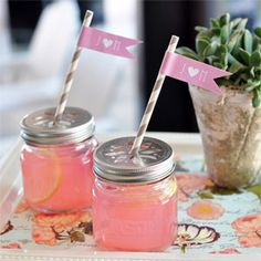 You can order these cut out lids. Wedding Favors & Party Supplies - Favors and Flowers :: Favor Packaging :: Favor Bottles :: Mason Drinking Jars with Flower Lids Mason Jar Drinking Glasses, Mason Jar Drinks, Drinking Jars, Mini Mason Jars, Cocktail Cupcakes, Fresco, Cheers, Smoothies, Rose Bonbon