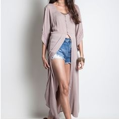 LAST PRICE DROP Long duster top Lace up back duster. Slightly over sized. 65% cotton 35% poly. This is my new favorite thing. So cute with a pair of shorts. PRICE FIRM UNLESS BUNDLED Boutique Tops