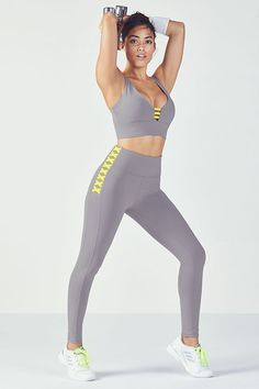 Reach new heights in our ultra-stylish set, featuring a high-support sports bra and matching high-rise leggings, both designed with a standout contrast lace-up design.