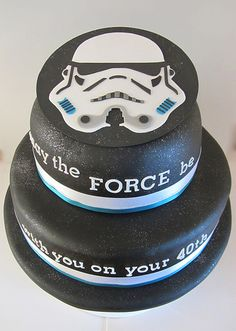 Easier to make than Death Star cake, just print a storm trooper face, cut to match stencil, fondant, and tadaaaa!