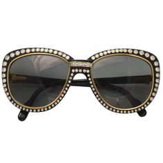 CARTIER PARIS 18KT Gold Sunglasses with 188 Diamonds  France  1980s  Custom order sunglasses by Cartier-Paris, in black plastic trimmed in 18KT gold, with 188 collet set diamonds, in excess of 7 1/2 carats, in original box. We have never seen another pair and assume that these are one-of-a-kind.