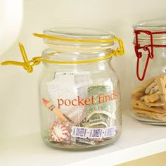 Laundry room organization - pocket finds jar via BHG