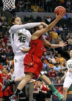 Louisville's guard Shoni Schimmel shoots and is fouled by Baylor's Brittney Griner during the second half of a regional semifinal game in the women's NCAA college basketball tournament in Oklahoma City, Sunday, March 31, 2013.