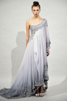 love the way it drapes over the body, reminds me of a waterfall; Marchesa Spring'11